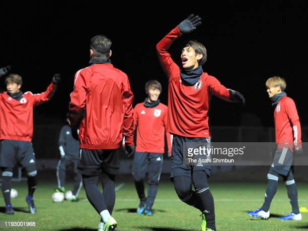Sho Sasaki and Japanese players warm up during a training session on December 9, 2019 in Busan, South Korea.