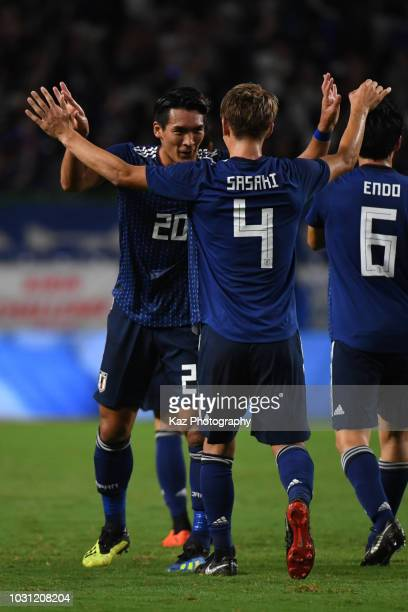 Sho Sasaki of Japan celebrates the opener with his team mate Tomoaki Makino of Japan during the international friendly match between Japan and Costa...