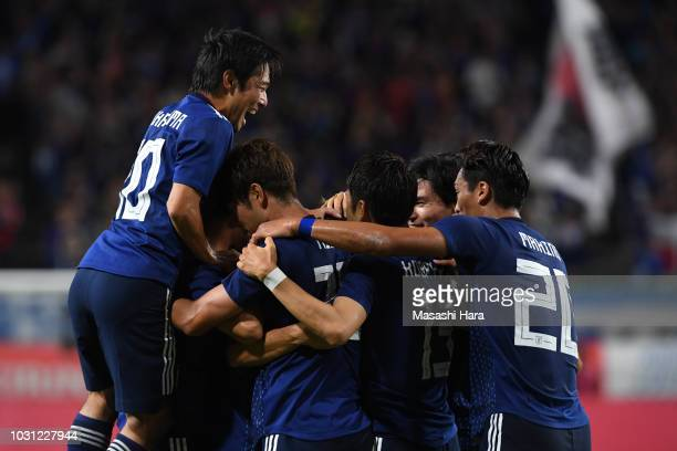 Sho Sasaki of Japan celebrates with teammates after scoring the opening goal during the international friendly match between Japan and Costa Rica at...