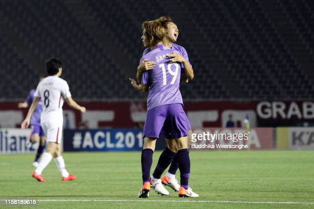 Sho Sasaki of Sanfrecce Hiroshima celebrates scoring his side's second goal with his team mate Kyohei Yoshino during the AFC Champions League round...