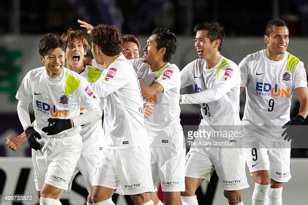 Sho Sasaki of Sanfrecce Hiroshima celebrates scoring his team's second goal with his team mates during the J.League Championship Final frist leg...