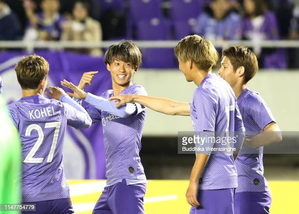 Sho Sasaki of Sanfrecce Hiroshima celebrates with teammates after scoring an opening goal during the AFC Champions League Group F match between...