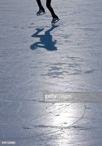 shoadow and silhouette of figure skater on ice - アイススケート場 ストックフォトと画像