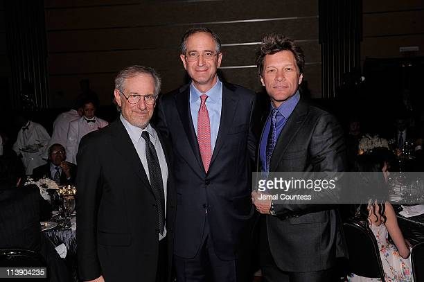 USC Shoah Foundation Institute Founder Steven Spielberg Ambassador for Humanity Honoree Brian L Roberts and Jon Bon Jovi attend the Ambassadors for...