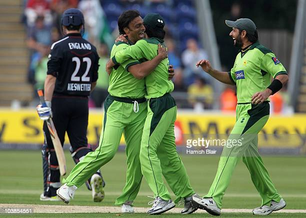 Shoaib Akhtar of Pakistan celebrates with team mate Fawad Alam after taking the wicket of Craig Kieswetter of England during the NatWest T20...
