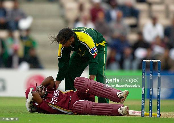 Shoaib Akhtar of Pakistan checks on West Indies batsman Brian Lara after hitting him with a 92mph bouncer during the ICC Champions Trophy Semi Final...