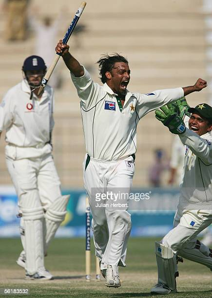 Shoaib Akhtar of Pakistan is congratulated by college Kamran Akmal as he celebrates the wicket of Steve Harmison and a test victory on the fifth and...