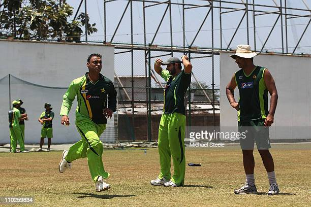 Shoaib Akhtar of Pakistan who has announced his retirement from international cricket bowls during a nets session as captain Shahid Afridi and coach...