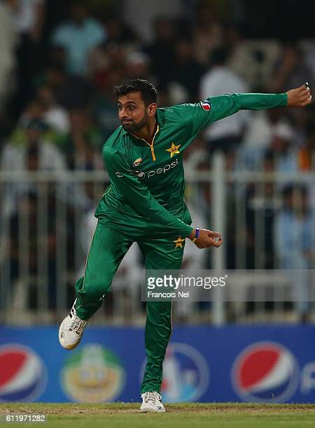 Shoaib Malik bowls during the second One Day International match between Pakistan and West Indies at Sharjah Cricket Stadium on October 2 2016 in...