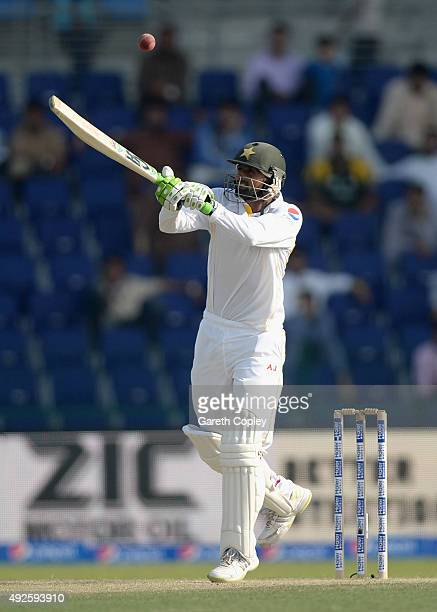 Shoaib Malik of Pakistan bats during day two of the 1st Test between Pakistan and England at Zayed Cricket Stadium on October 14 2015 in Abu Dhabi...