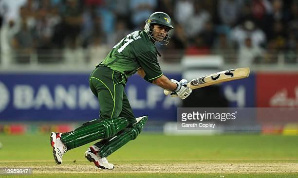 Shoaib Malik of Pakistan bats during the 1st International Twenty20 Match between Pakistan and England at Dubai International Stadium on February 23...