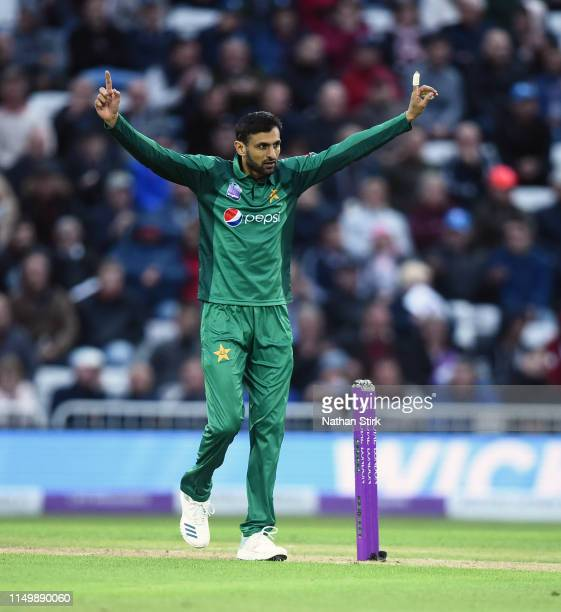 Shoaib Malik of Pakistan celebrates as he gets Moeen Ali of England out during the 4th Royal London ODI match between England and Pakistan at Trent...