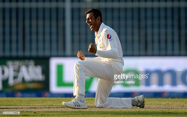 Shoaib Malik of Pakistan celebrates dismissing Ian Bell of England during day four of the 3rd Test between Pakistan and England at Sharjah Cricket...