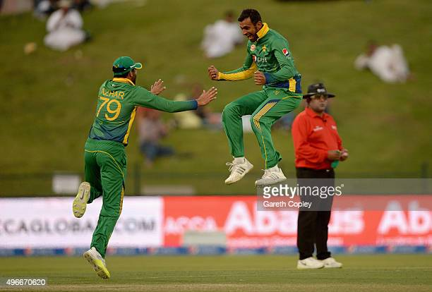 Shoaib Malik of Pakistan celebrates with Azhar Ali after dismissing James Taylor of England during the 1st One Day International between Pakistan and...