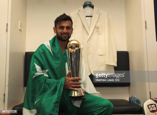 Shoaib Malik of Pakistan celebrates with the ICC Champions Trophy after his team win over India during the ICC Champions Trophy Final between...