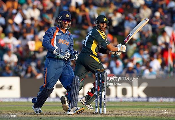 Shoaib Malik of Pakistan hits out during the ICC Champions Trophy group A match between India and Pakistan at Centurion on September 26 2009 in...