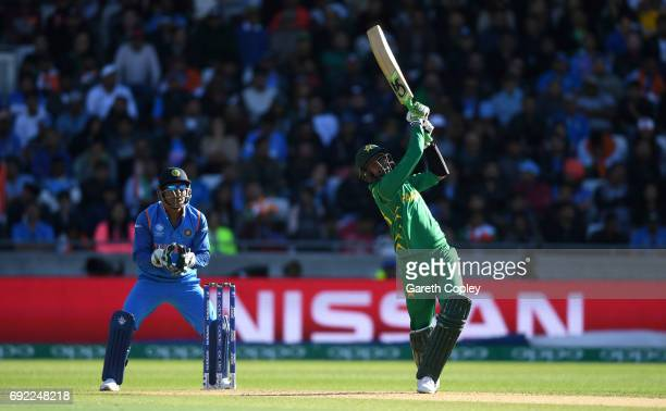 Shoaib Malik of Pakistan hits out for six during the ICC Champions Trophy match between India and Pakistan at Edgbaston on June 4 2017 in Birmingham...