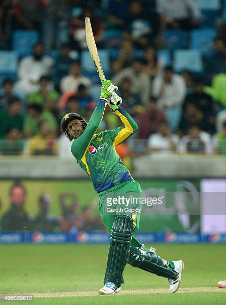 Shoaib Malik of Pakistan hits out for six runs during the 4th One Day International between Pakistan and England at Dubai Cricket Stadium on November...