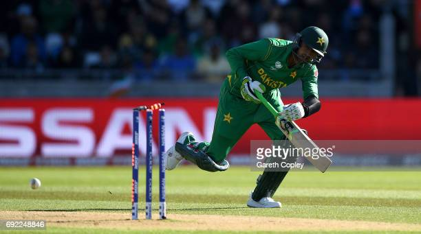 Shoaib Malik of Pakistan is run out by Ravindra Jadeja of India during the ICC Champions Trophy match between India and Pakistan at Edgbaston on June...