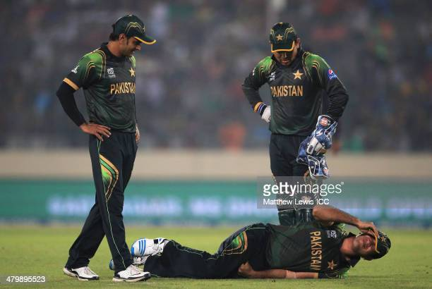 Shoaib Malik of Pakistan lies on the ground after being hit by a cricket ball in his mid section during the ICC World Twenty20 Bangladesh 2014 match...