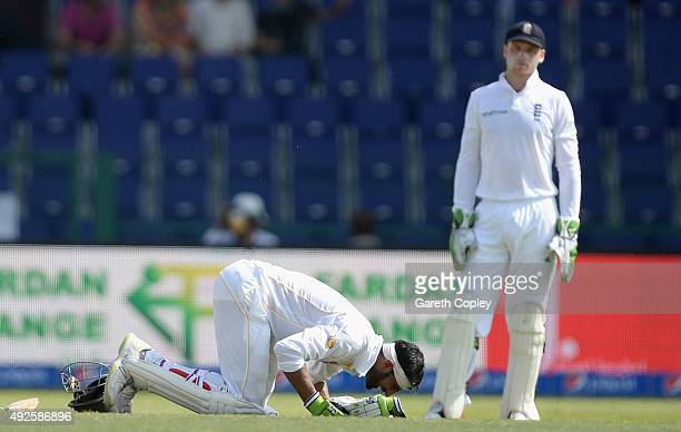 Shoaib Malik of Pakistan prays after reaching his double century during day two of the 1st Test between Pakistan and England at Zayed Cricket Stadium...