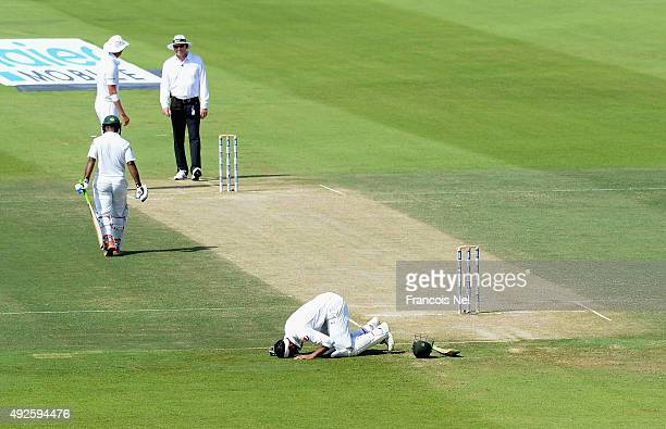 Shoaib Malik of Pakistan reacts after reaching his double century during Day Two of the First Test between Pakistan and England at Zayed Cricket...