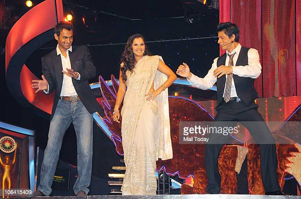 Shoaib Malik Sania Mirza and Shah Rukh Khan perform during the Sahara Sports Awards 2010 in Mumbai on October 302010
