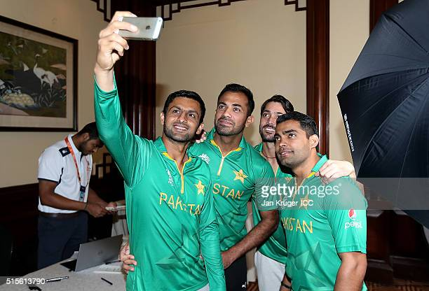 Shoaib Malik takes a selfie with team mates Wahab Riaz Anwar Ali and Umar Akmal during a Pakistan headshots session on March 14 2016 in Kolkata India