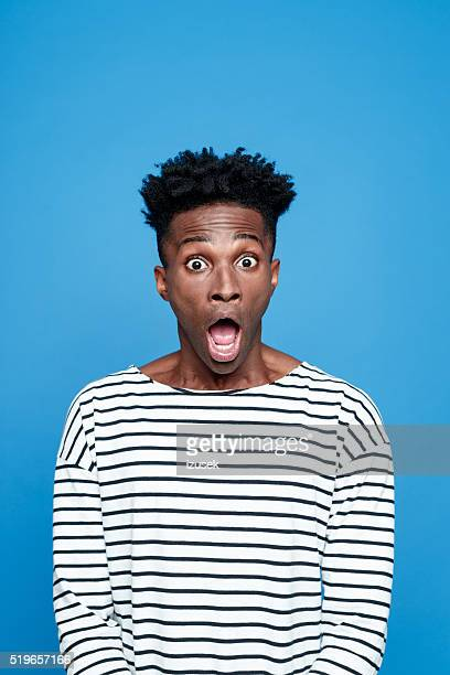 shock, afro american staring at camera with mouth open - mouth open stock pictures, royalty-free photos & images