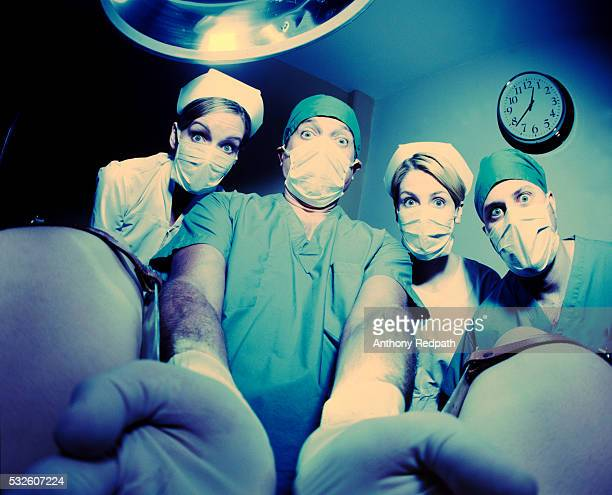 shock at a baby's birth - funny surgical masks stock pictures, royalty-free photos & images