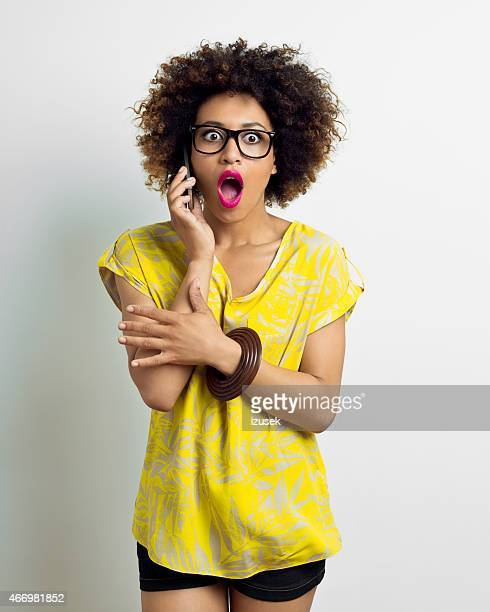 Shocked Afro Young Woman on Phone