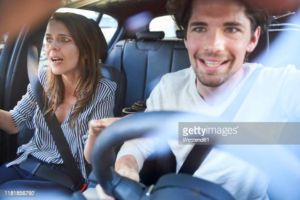 shocked couple in a car with man driving - horrible car accidents stock pictures, royalty-free photos & images