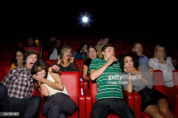 Shocked couples in the movie theater