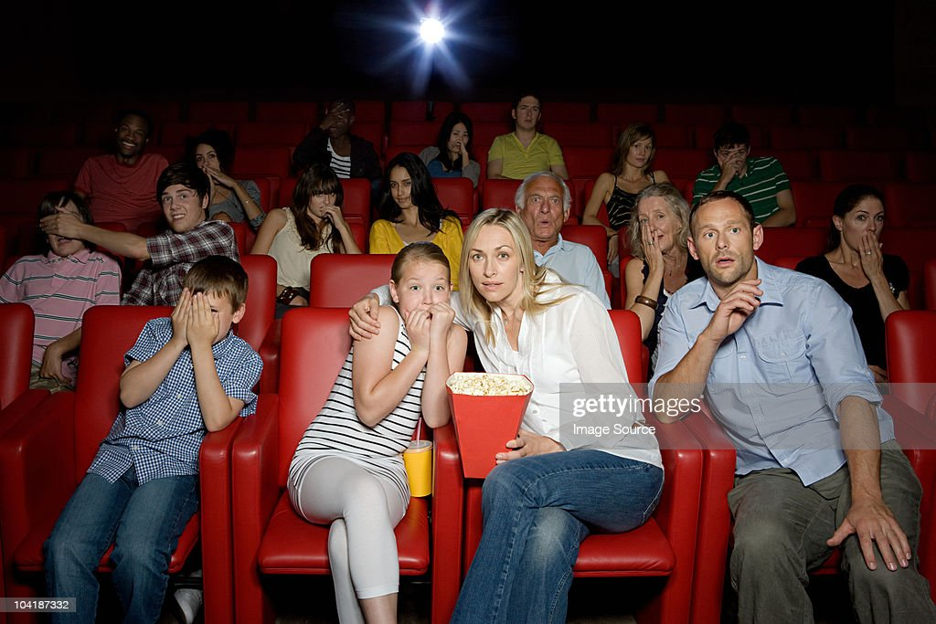 Shocked family in movie theater : Stock Photo