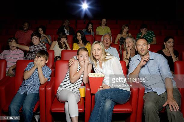 Shocked family in movie theater