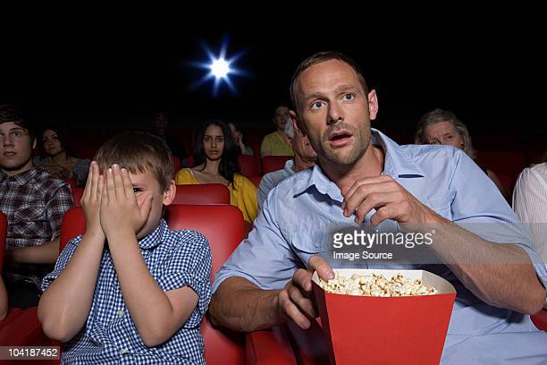 Shocked father and son in movie theater