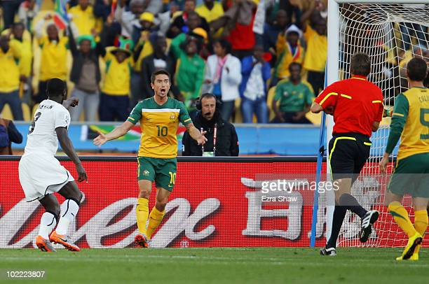 A shocked Harry Kewell of Australia as referee Roberto Rosetti sends him off for handball and awards Ghana a penalty during the 2010 FIFA World Cup...
