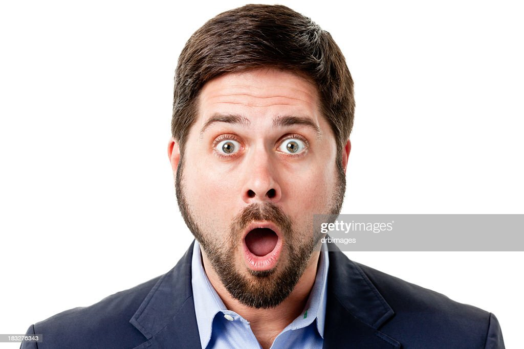 Shocked Man Gasps And Raises Eyebrows : Stock Photo