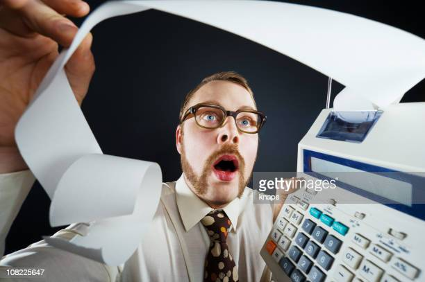 shocked over the finances - economist stock pictures, royalty-free photos & images