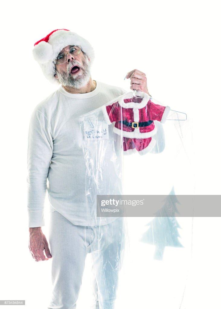 Shocked Santa Claus Crisis - Shrunken Dry Cleaned Santa Costume : Stock Photo