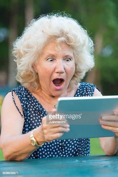Shocked senior woman