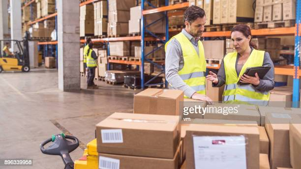 shocked supervisor giving instructions to employee - post structure stock photos and pictures
