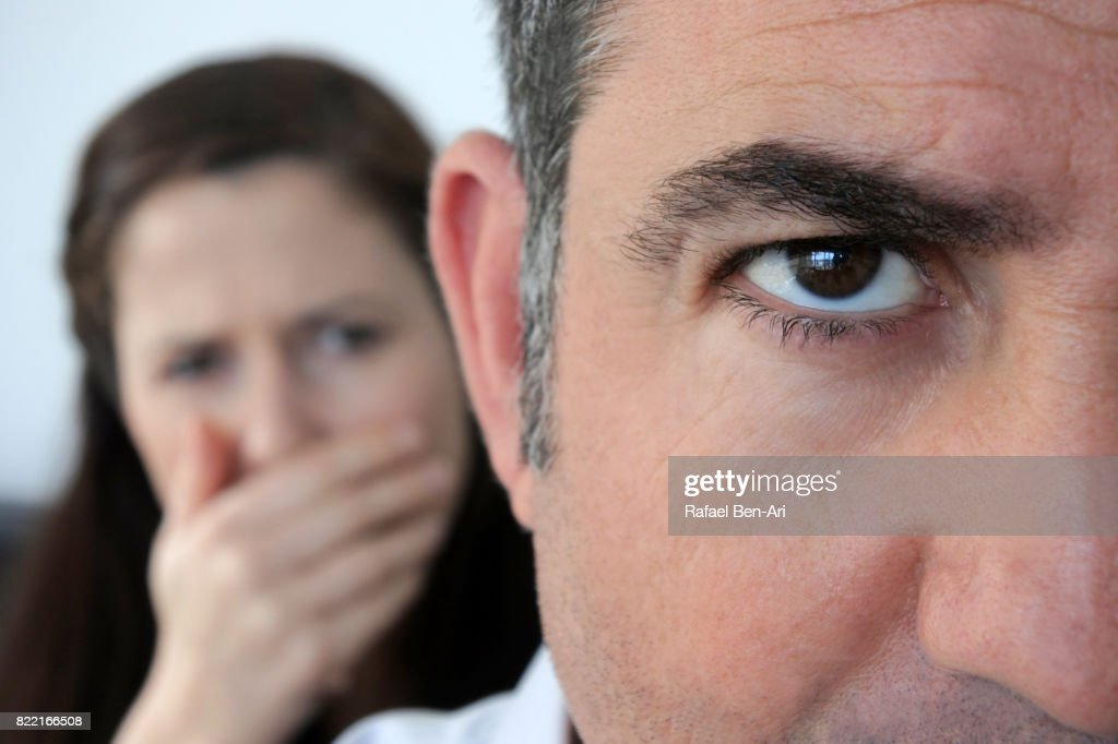 Shocked wife looks her a husband in disbelief : Stock Photo
