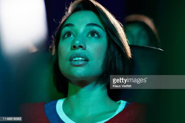 shocked woman at movie theater - filmindustrie stock-fotos und bilder