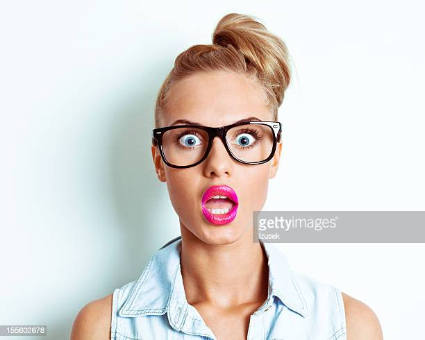 shocked woman - pulling funny faces stock pictures, royalty-free photos & images