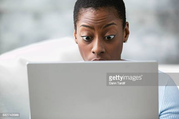 Shocked Woman Using a Laptop