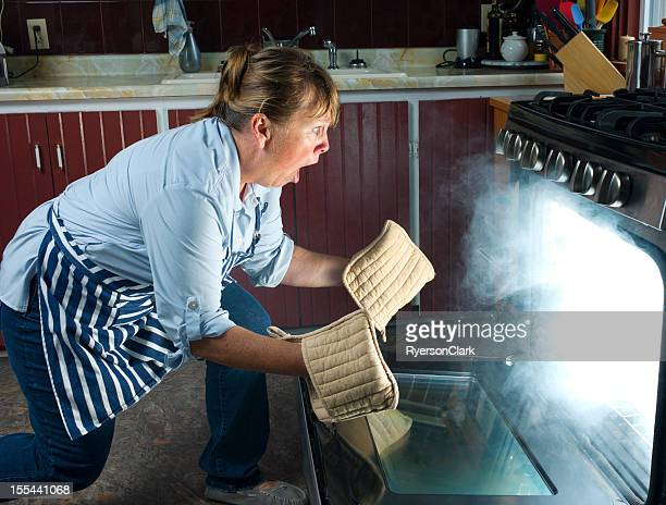 Shocked Woman watches Oven Fire While Cooking in the Kitchen
