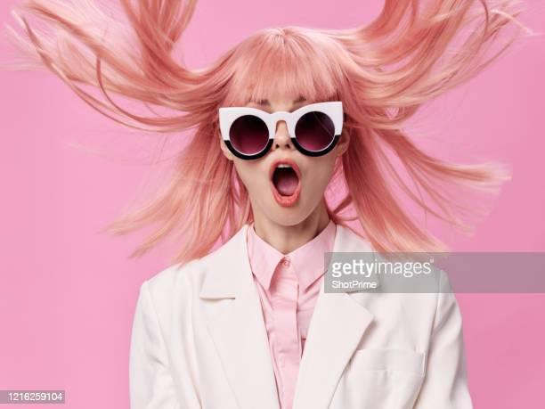 shocked woman with pink hair scattered hair in different directions from surprise - majestic stock pictures, royalty-free photos & images
