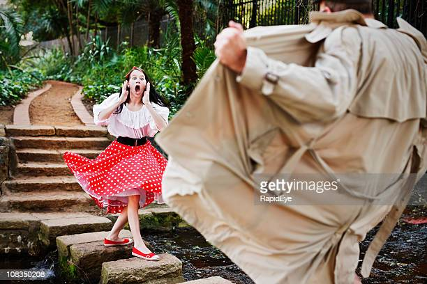 shocked young girl is horrified by raincoat clad flasher - female flasher stock pictures, royalty-free photos & images