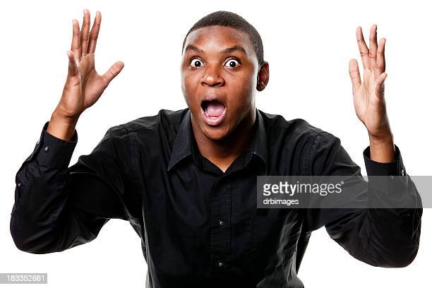 Shocked Young Man Gasping With Arms Up